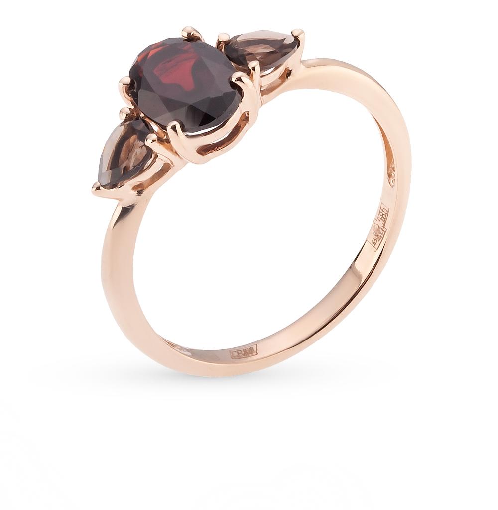 Фото «золотое кольцо с гранатом и топазами»
