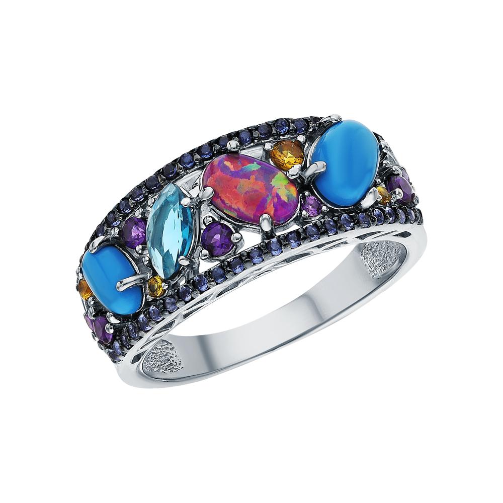Фото «Серебряное кольцо с бирюзой, фианитами, опалами имитациями и лондонами топазами»