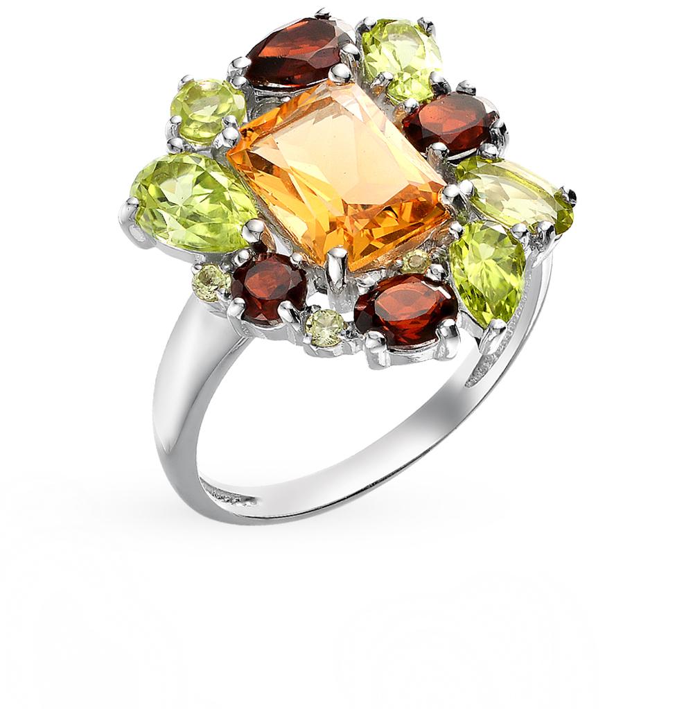 Фото «Серебряное кольцо с хризолитом, гранатом и цитринами»