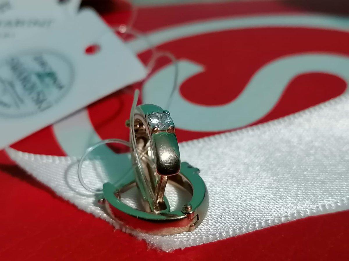 Серебряные серьги позолоченные с фианитами  swarovski.