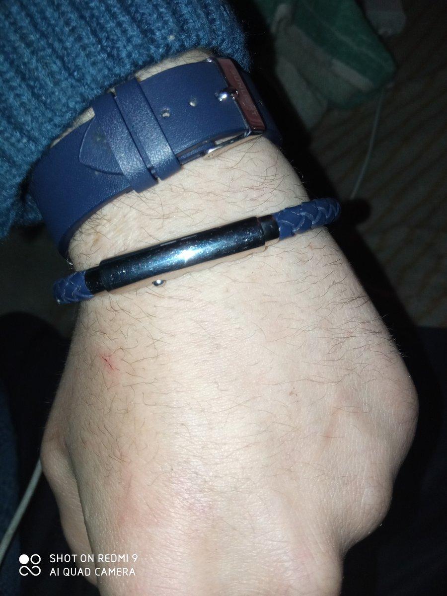 Мужской браслет из кожи и стали.